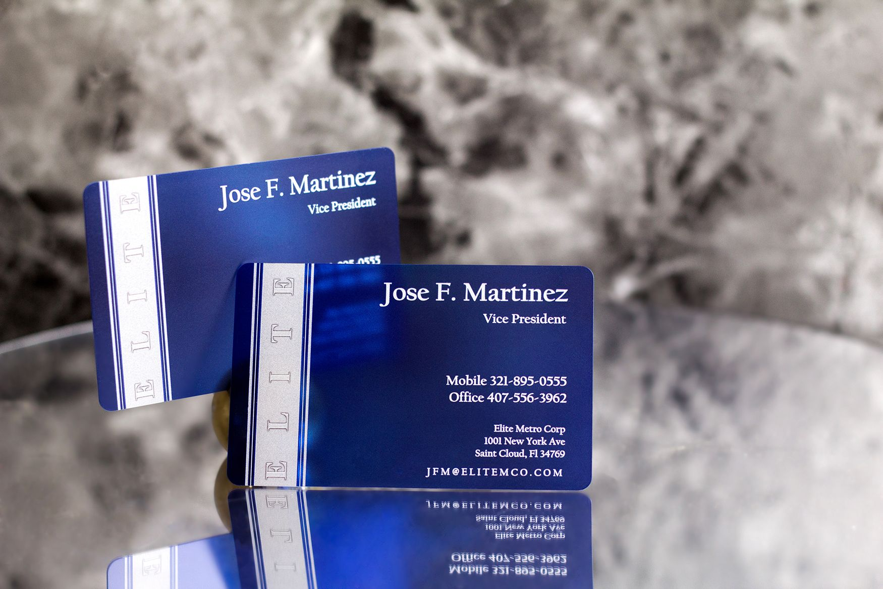 elite satin business card with a custom silver foil stamp