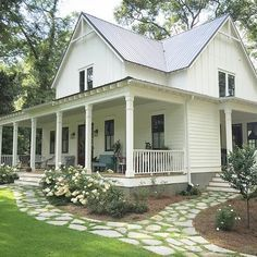 This is my dream home right here. I love the wrap around porch and all the…