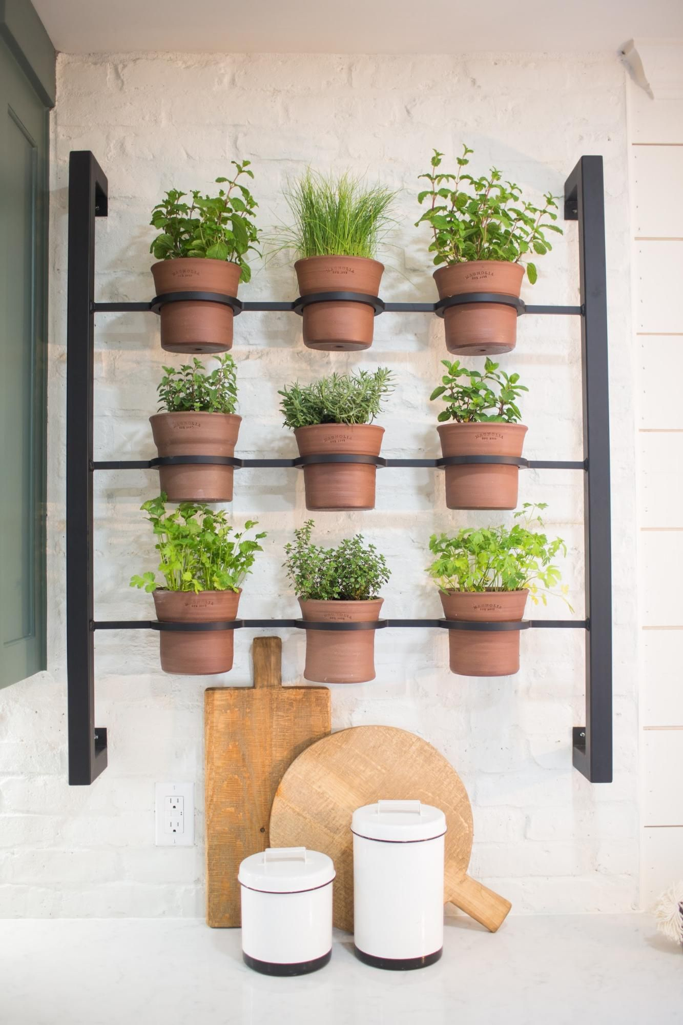 I designed this wall planter that my welder cody built and installed these terracotta pots that