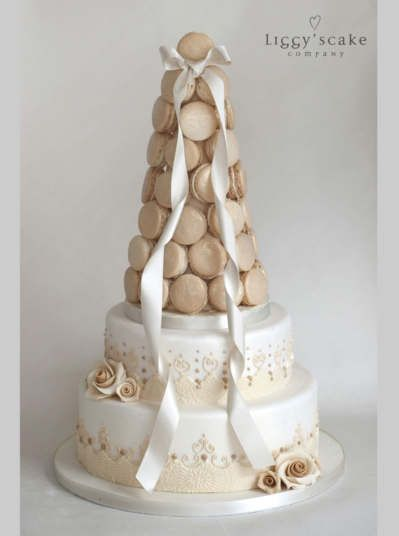 Bridal Macaron Tower   Wedding Cake. Macaron tower with beautiful piped detail finished and edible sugar roses.