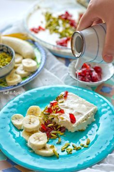 Lebanese nights dessert or madlouka a heavenly combination of semolina pudding, cream, nuts, syrup and fruit.jpg