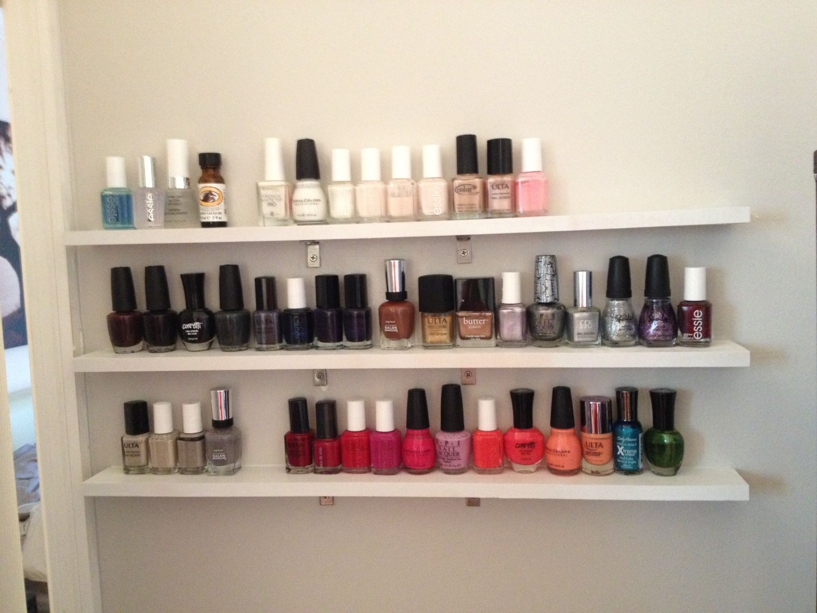 DIY nail polish shelves. My husband put these thin slabs of wood up ...