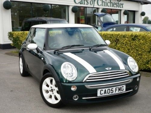 The New Mini Cooper S In British Racing Green With White Roof And Stripes