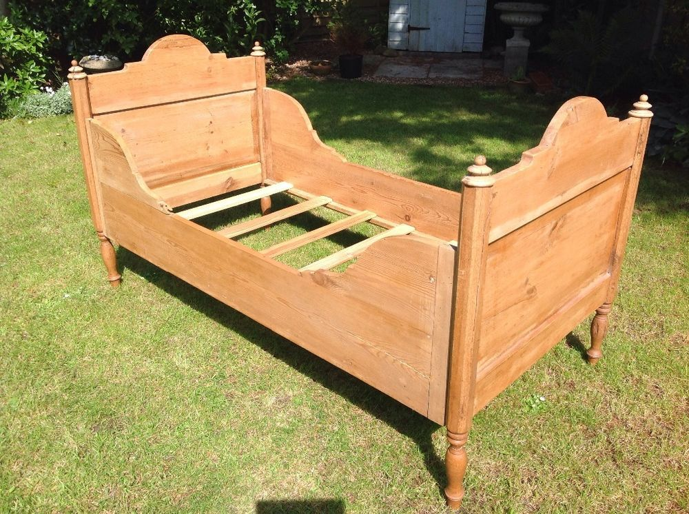Antique European pine child's bed. This bed is similar to