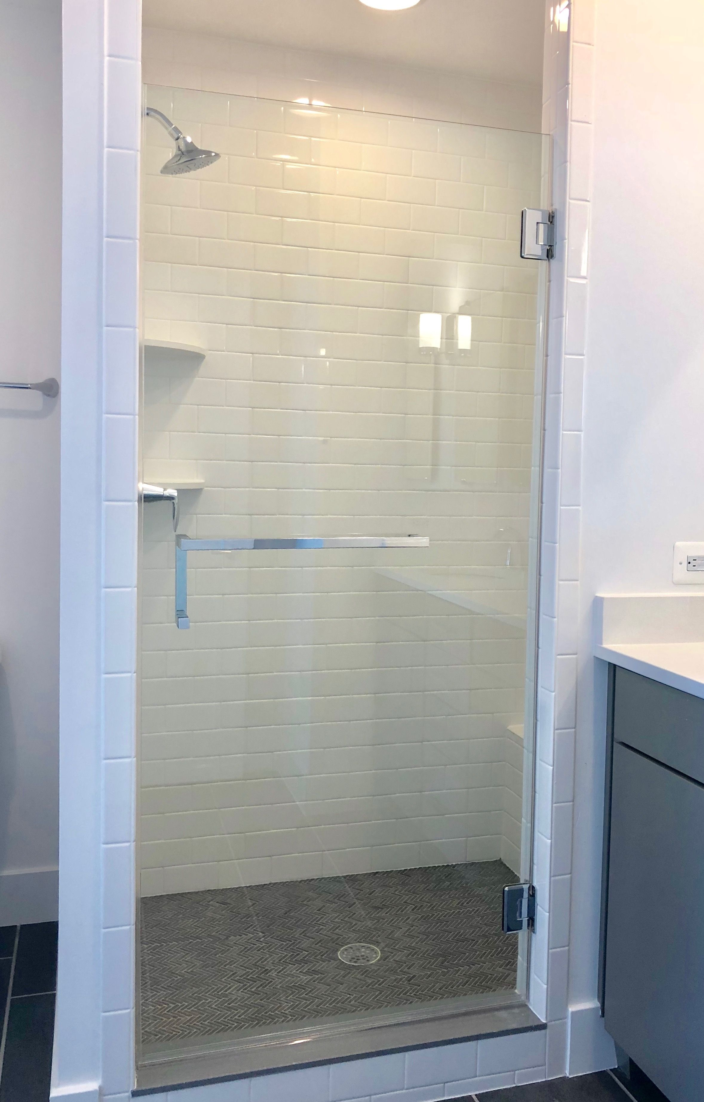 Frameless Shower Installation In Baltimore Md With A Square Towel