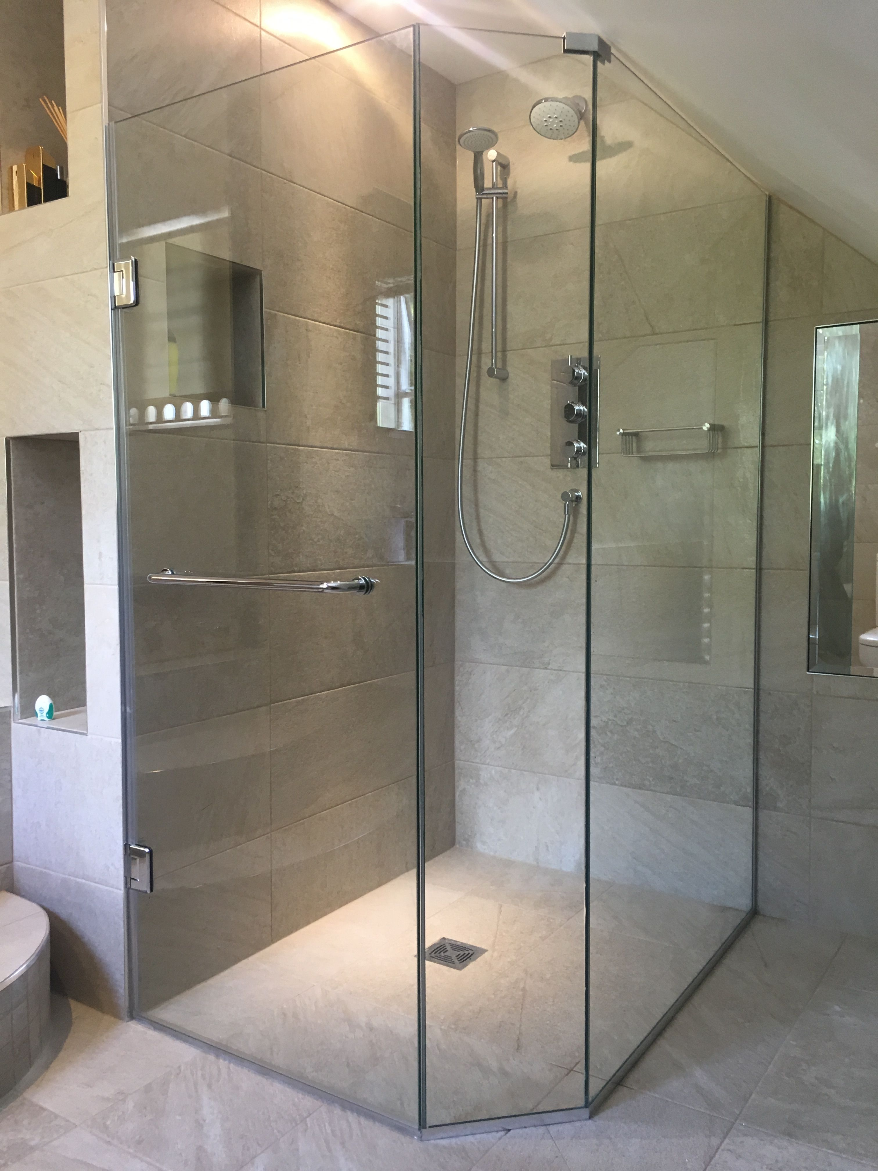 Fully Frameless Shower Enclosure Installed Into Loft Conversion Door And Panel Shaped To Sloped Small Attic Bathroom Sloped Ceiling Bathroom Small Shower Room
