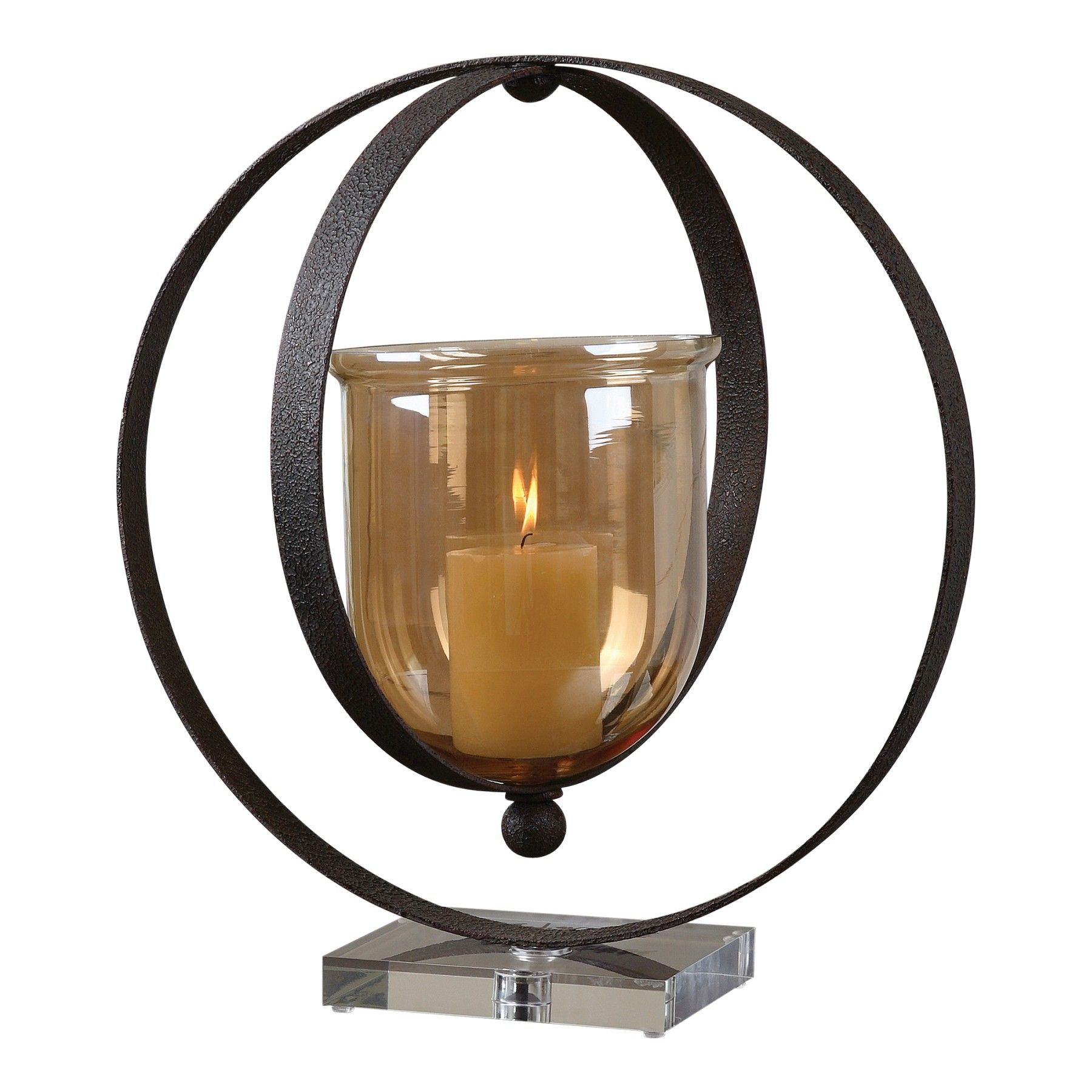 Dark, rust bronze metal rings suspend the transparent amber glass globe; all seated on a crystal base. #uttermost #candles #accessories