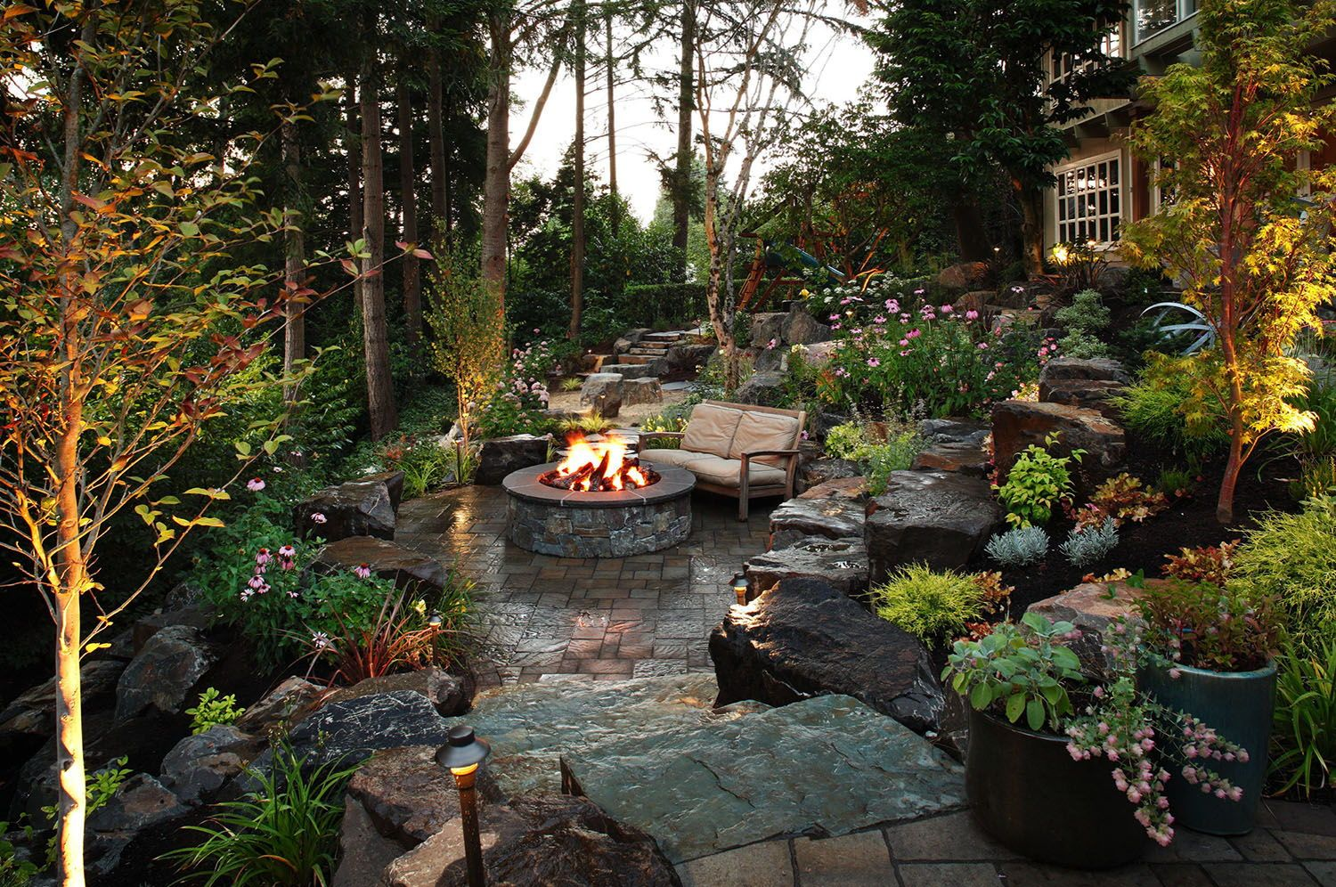 21 Absolutely Fantastic Backyard Gardens Ideas With Cozy Fire Pits Fire Pit Landscaping Sloped Garden Outdoor Fire Pit