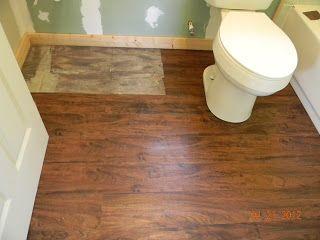 Gunstock oak luxury vinyl plank flooring from lowe 39 s for - Can you use laminate flooring in a bathroom ...
