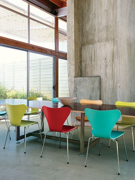 Contemporary Dining Room Chairs Pleasing Colorful Dining Room Chairs Brighten Up The Concrete Walls Of This Decorating Design