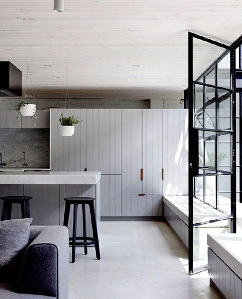Black Kitchen Unit Doors: Architects EAT Renovates Brick Warehouse To Spacious Loft