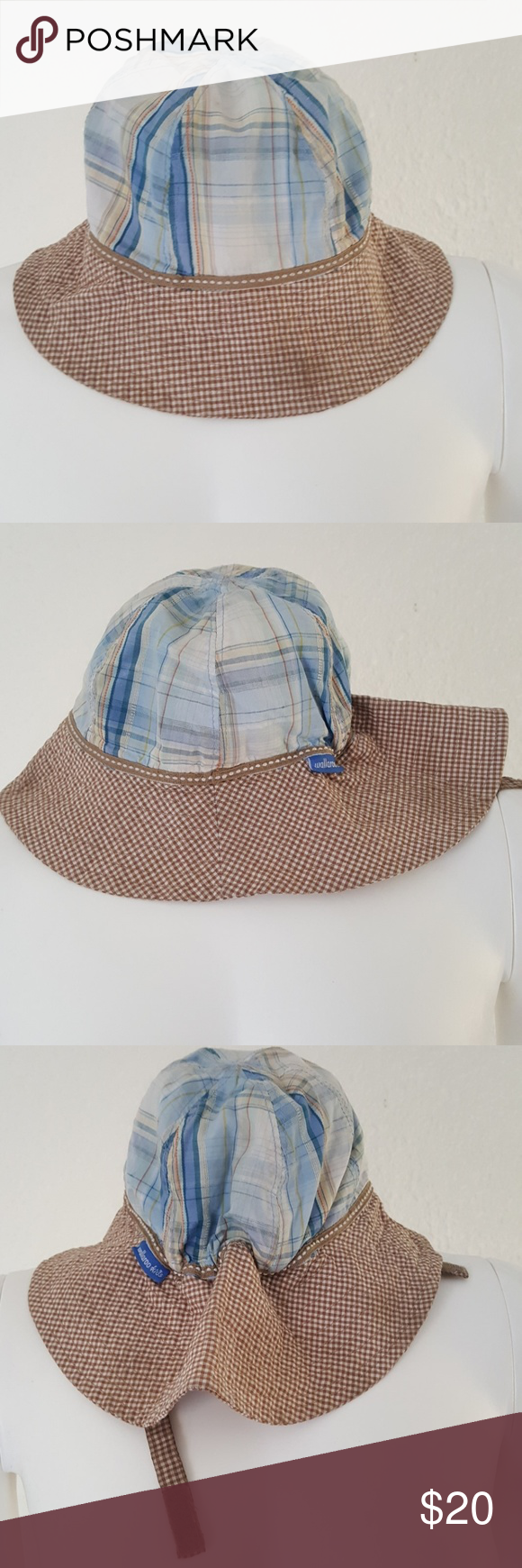 Wallaroo Kids Lids Platypus Bucket Floppy Hat Adorable toddler sized hat for a boy or girl by Wallaroo. From their kids line called Kids Lids, style name is Platypus. Extra wide brim forvadded protection at back of neck. Should fit kids ages 1 to 2-1/2 years old. Wide brim is same white tan plaid checks on both sides. Velcro chin strap. Terry blue is inside but could be reversible if you want, just cut white tag. Wallaroo Accessories Hats