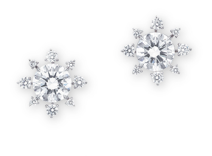 0e880085ab0ce A PAIR OF DIAMOND EARRINGS Of snowflake design, each set with a ...