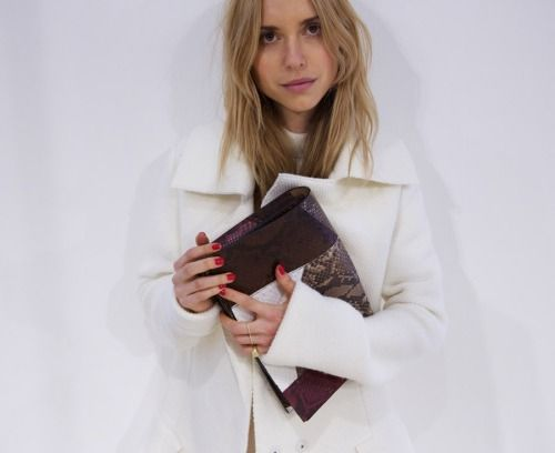 White coat + snake clutch + red nails