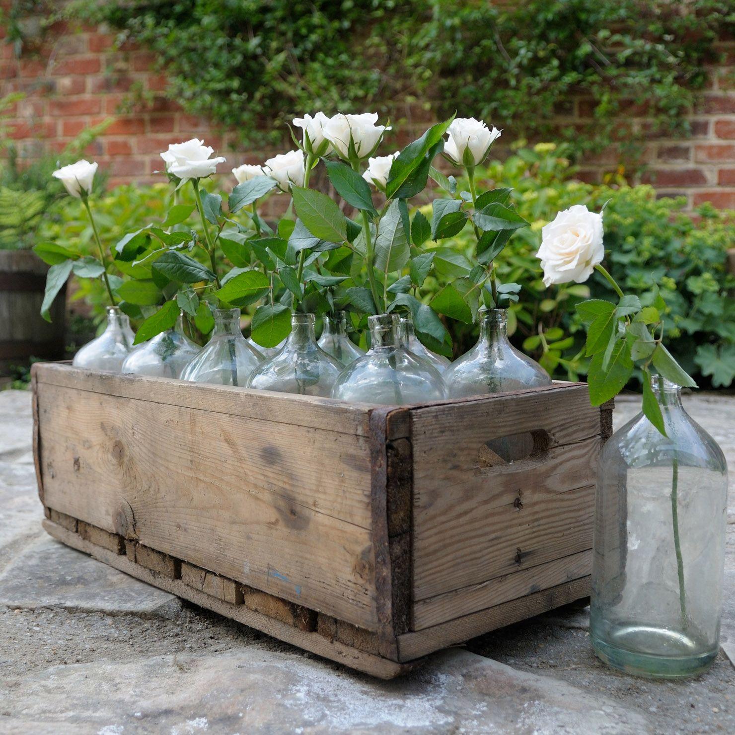 Antigua caja de botellas de vino con 10 botellas de cristal | ACHICA