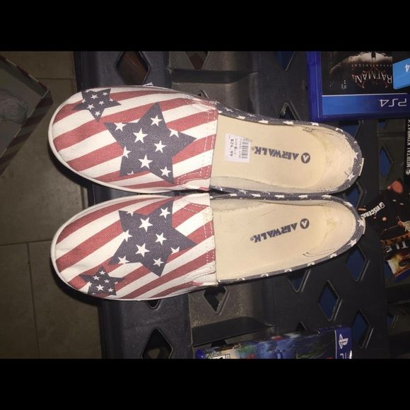 American flag slip ons All flaws shown in photo , NO FLAWS ON OUTSIDE OF SHOE, only little thing on the inside. Basically brand new , size 8.5 Shoes Flats & Loafers