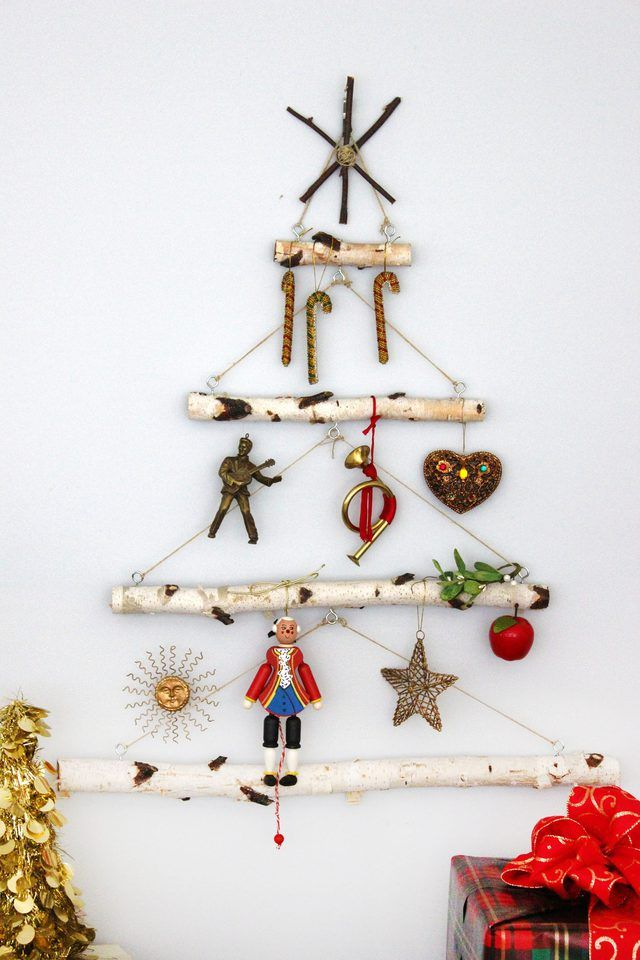 This Charming Wall Decoration Made With Ascending Birch Branches In The Shape Of A Christmas Tree Is A Ch Wall Christmas Tree Wood Reindeer Twig Christmas Tree