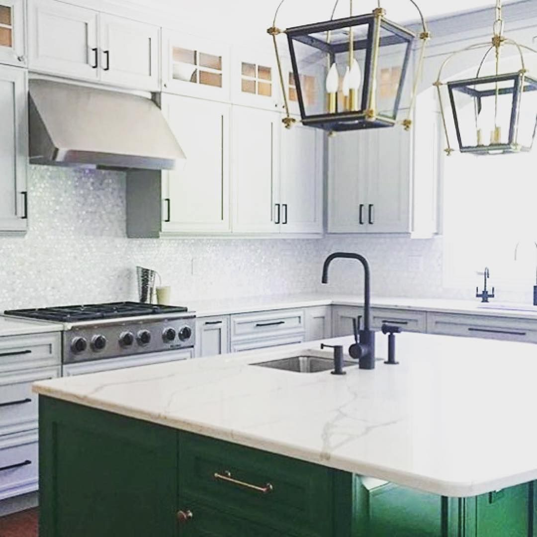 Kitchen featuring a custom green island and marble and pearl mosaic