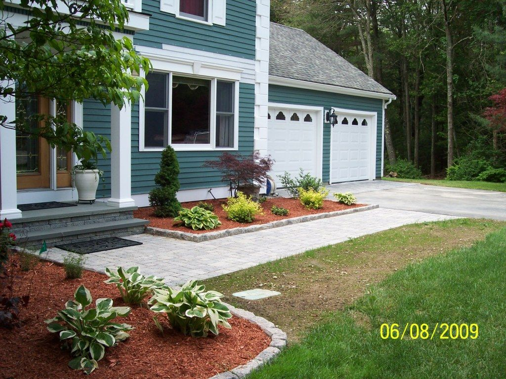 Front yard landscape project with new plants, front steps, walkway and  edging
