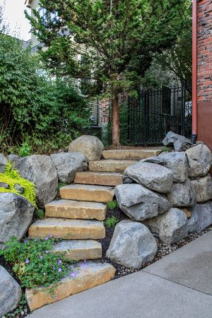 Natural Stone Steps And Boulder Retaining Walls Boulder Retaining Wall Pacific Garden Garden Design