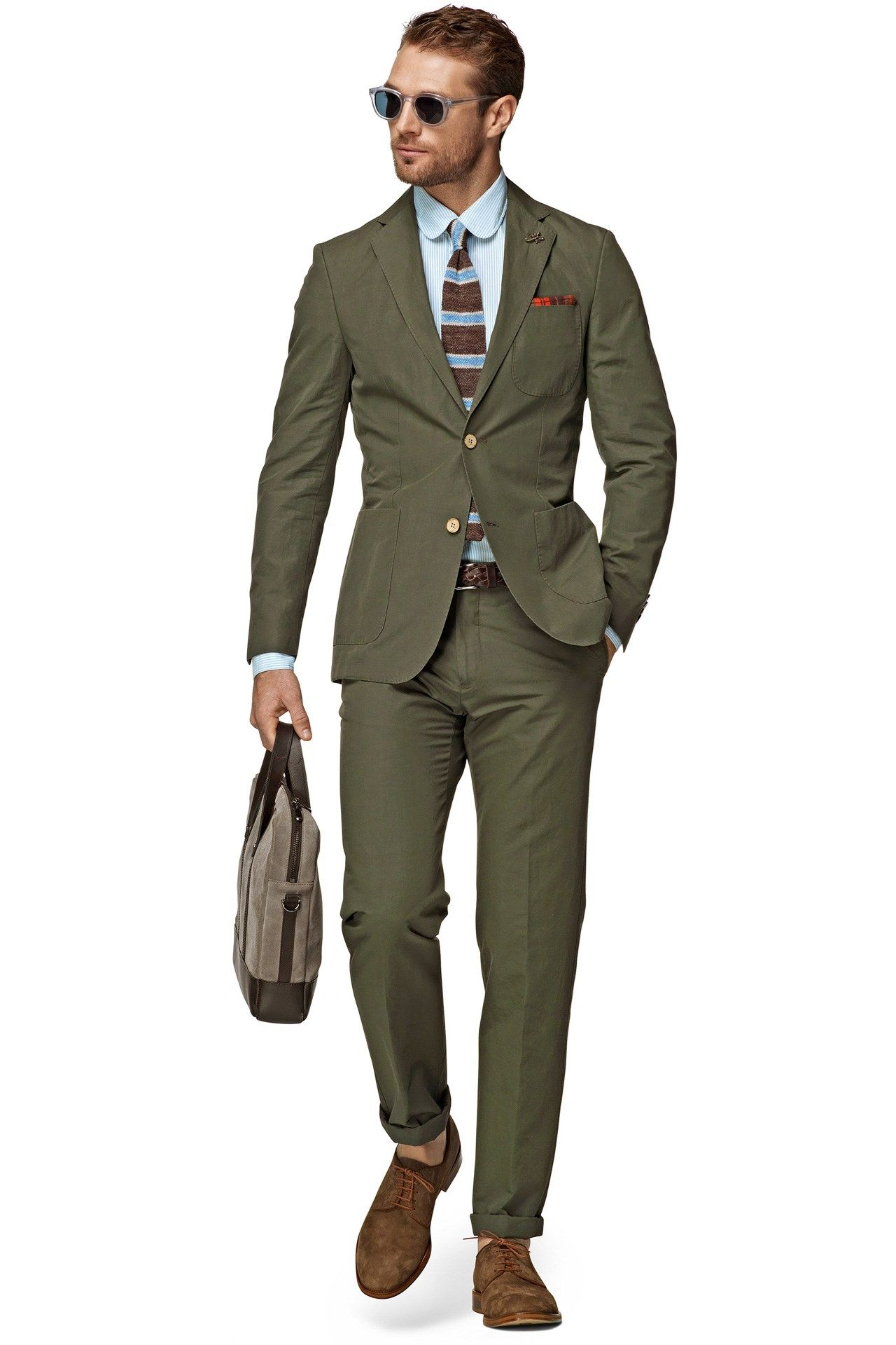 olive green colored suit cut from a lightweight cotton-linen blend ...