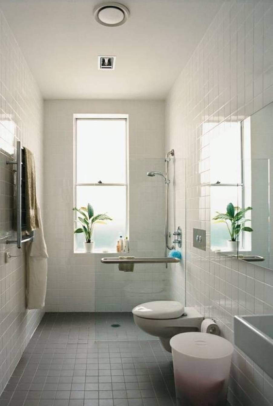 Narrow Bathroom Window With Small Toilet And Stainless Steel Towel Bar Also White Bathroom Tile Jpg 902 1 Tiny Bathrooms Small Narrow Bathroom Narrow Bathroom
