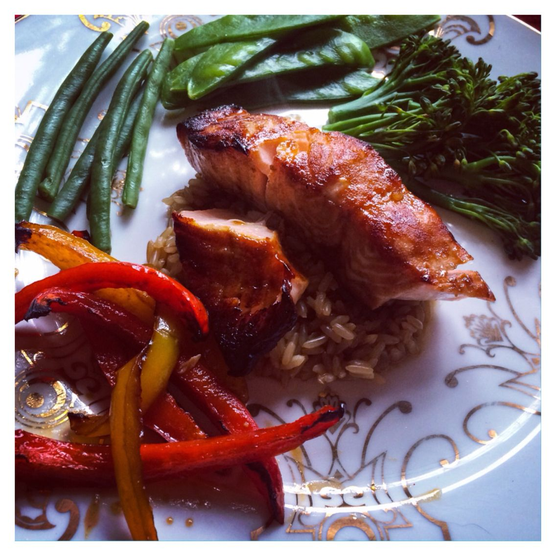 Grilled Salmon on a bed of brown rice and peppers.