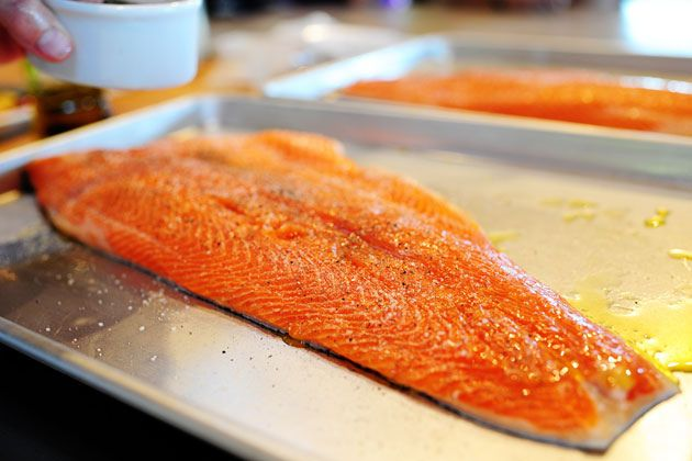 The best way to cook salmon...cover with olive oil, salt & pepper. put in a *cold oven* and set the temp to 400. leave it for 25 minutes...perfect.
