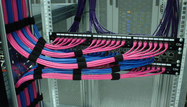 Running Pink And Blue Ethernet Cables Into Patch Panels And A Dell Powerconnect Switch Structured Cabling Patch Panels Cable Management