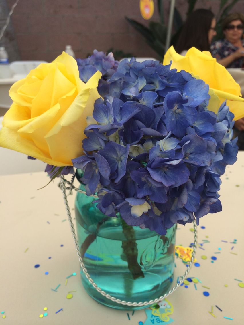 Gorgeous blue hydrangea and yellow roses in turquoise mason jar