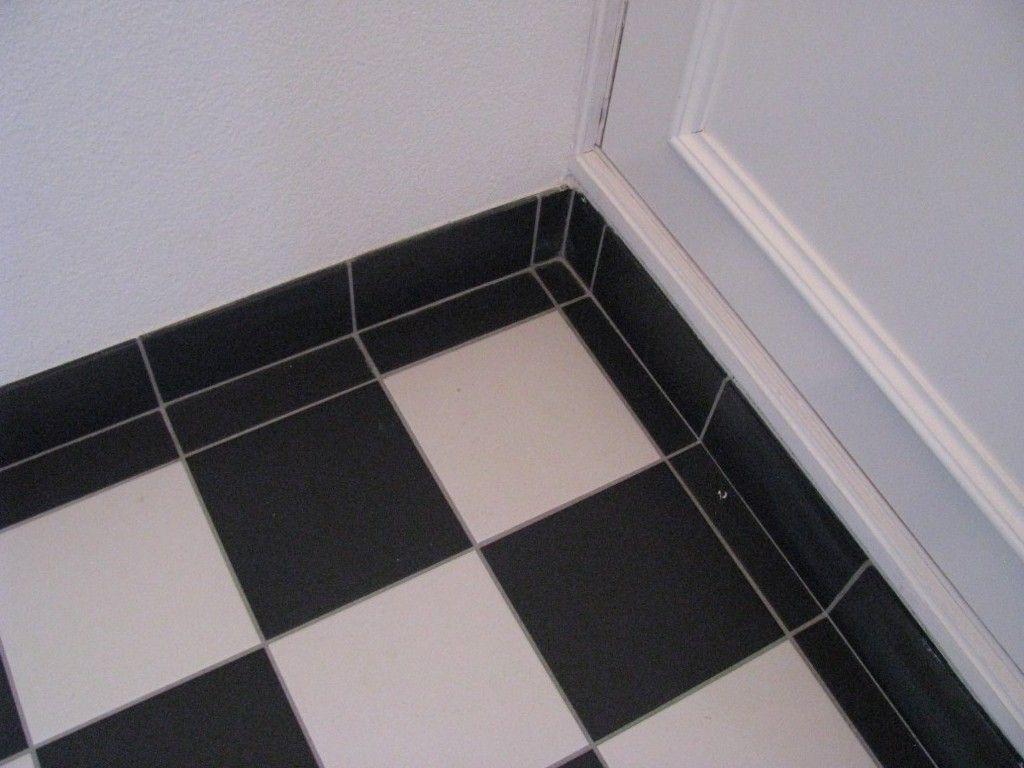 tegels limburg hal zwart wit geblokte vloer vakmanschap is
