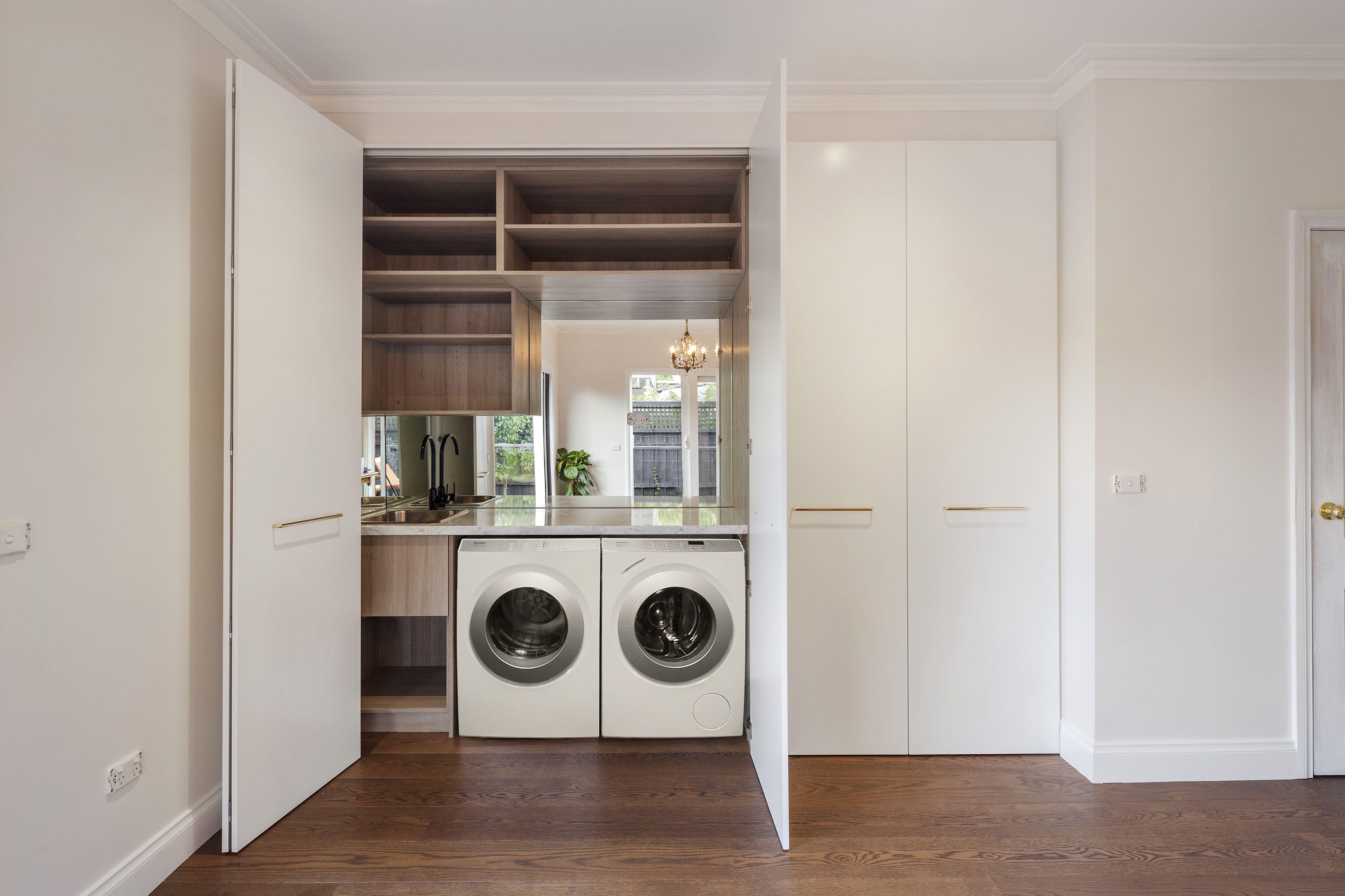 Hidden Euro Laundry White 2pac Doors With Brass Hardware Mirror