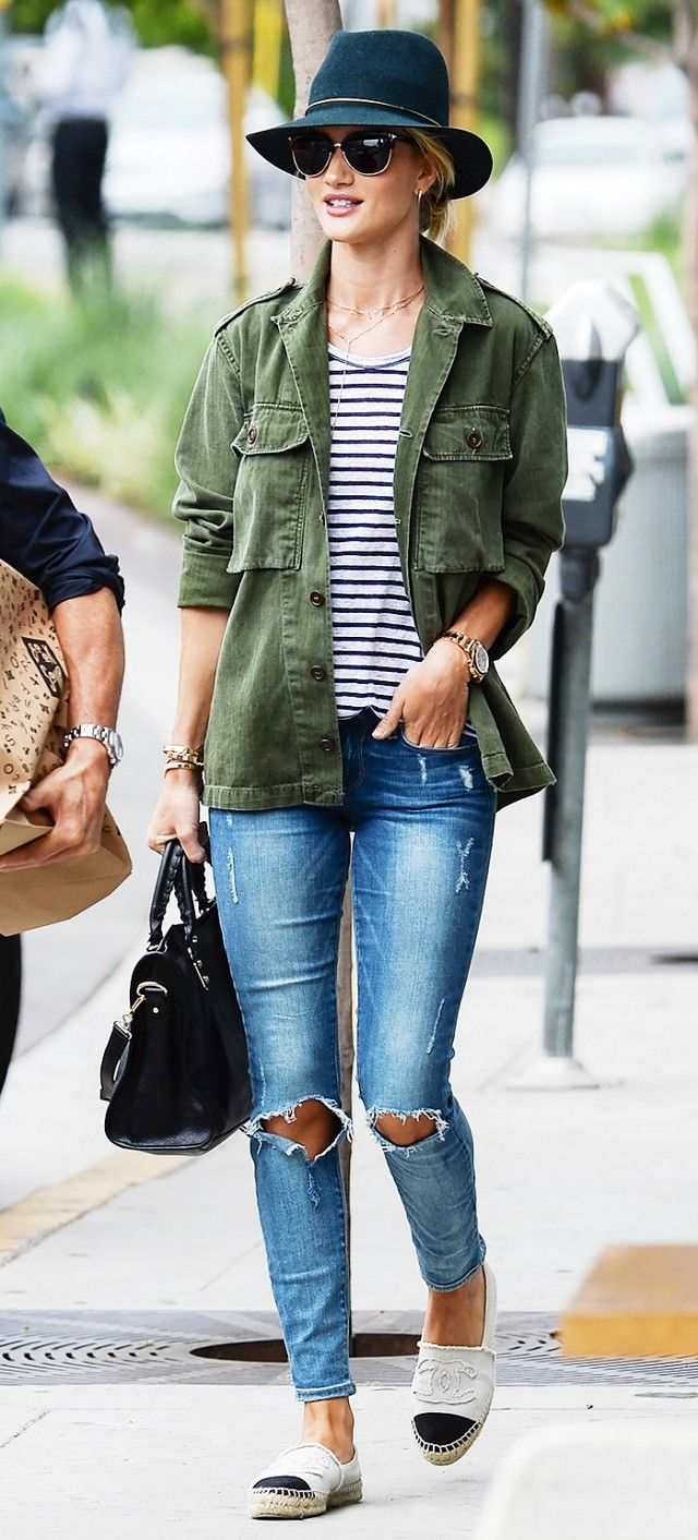 Rosie Huntington-Whiteley wears a striped t-shirt, army jacket, distressed jeans, and Chanel espadrilles.