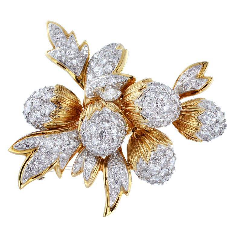 Vintage Platinum and 18 karat yellow vintage gold acorn pin with movable parts consisting of approximately 8.00 carats of full cut and single cut diamonds and one marquise diamond.