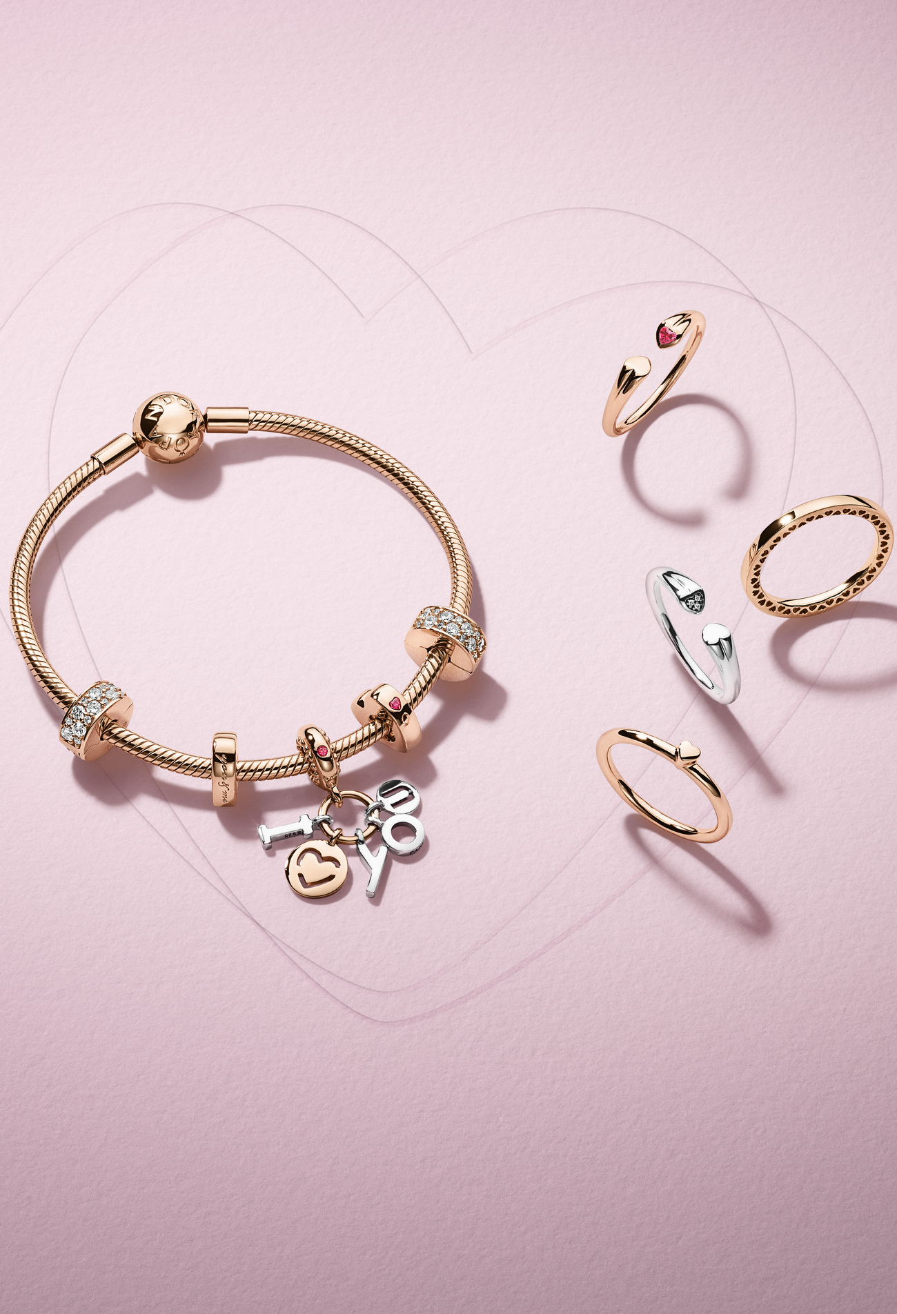 PANDORA Rose and sterling silver are perfect for creating an eye-catching look. Adornes with loving shimmering PANDORA charms and rings this look is ready to greet Valentine's Day in style.