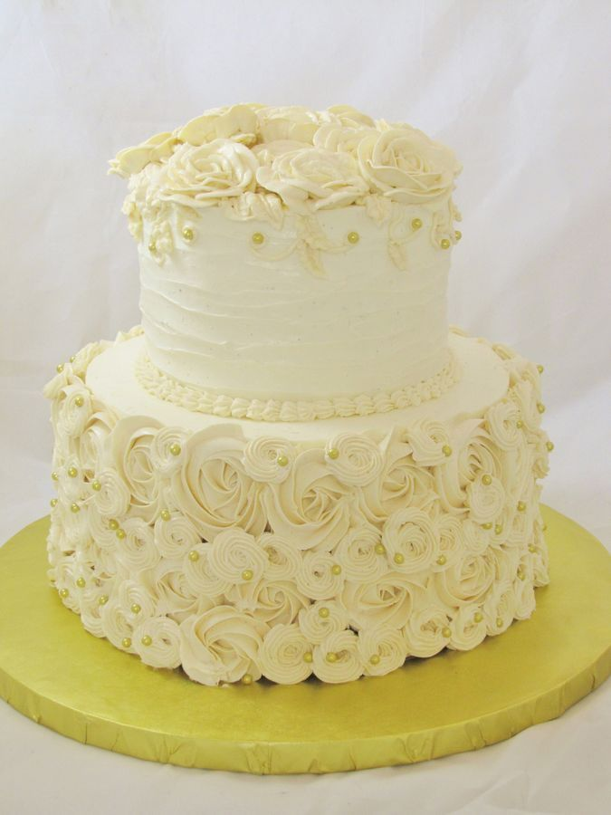 full view of round, piped buttercream two tier wedding cake with gold dragees by Sarah Gillespie ...