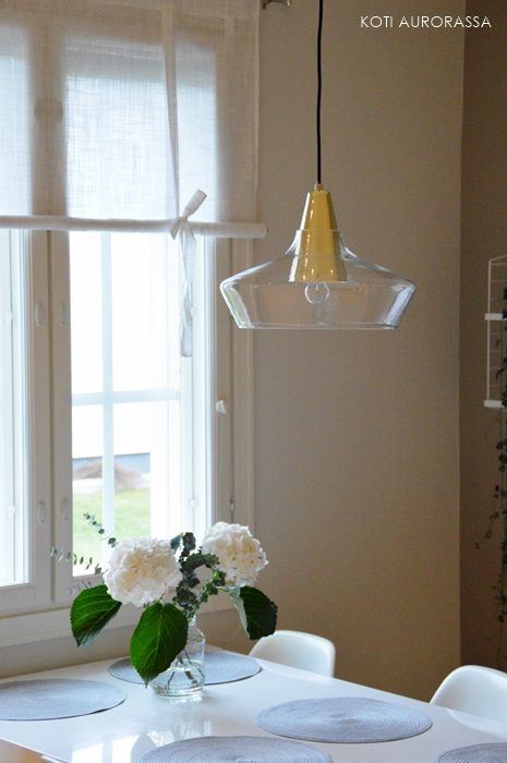 Modern and elegant luminaire in a finnish kitchen. @kotiaurorassa.blogspot.fi