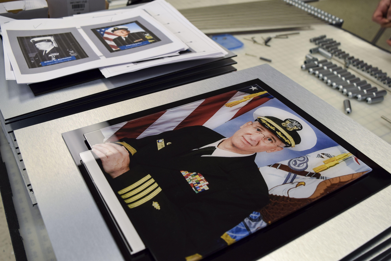 Custom built hanging hallway photo display for Naval