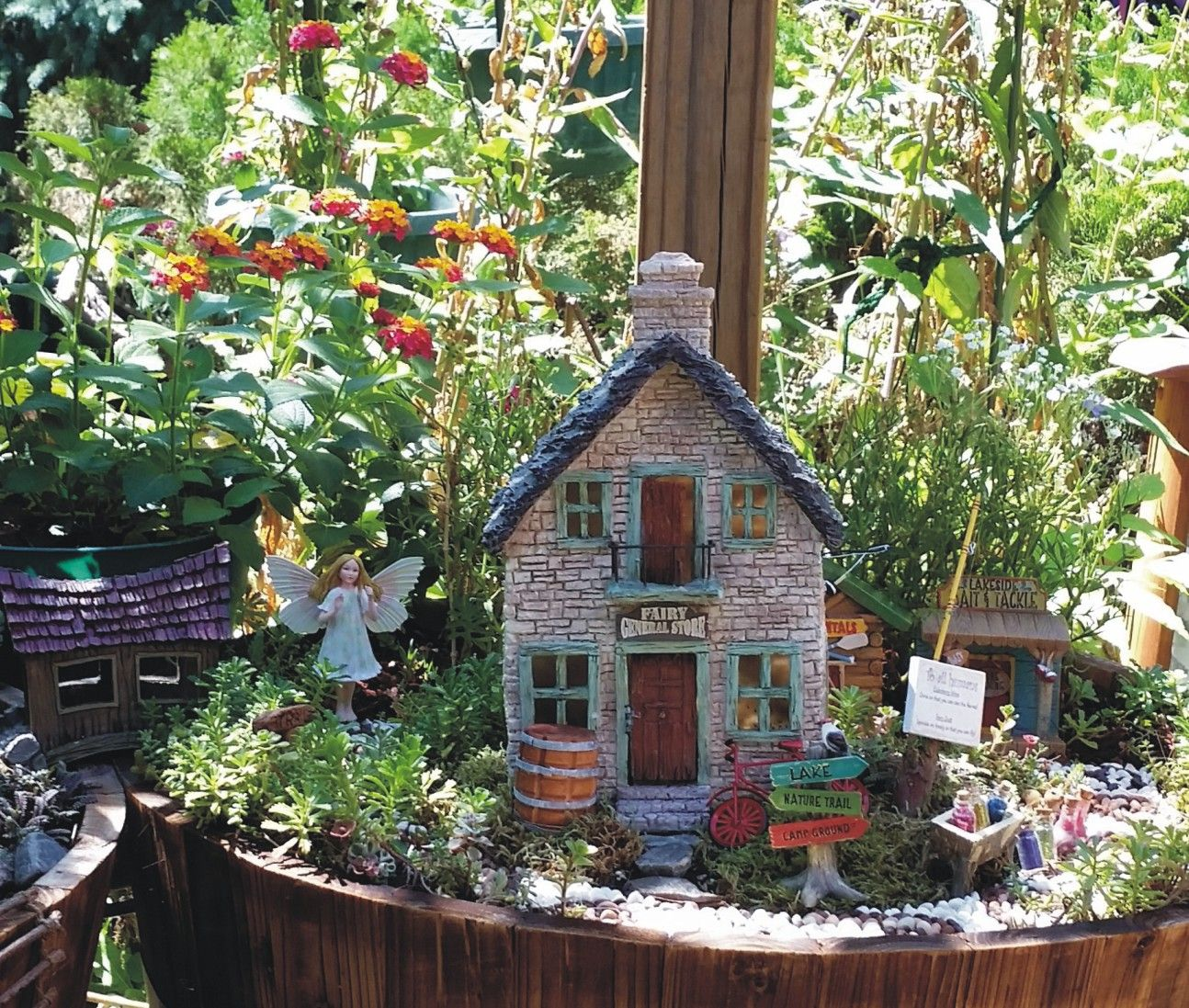 Miniature Fairy Garden    I like the green trim on the stone house ...