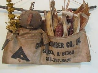 Old Lumber Co. apron filled with Prim Doll and Indian Corn...sweet fall decoration.
