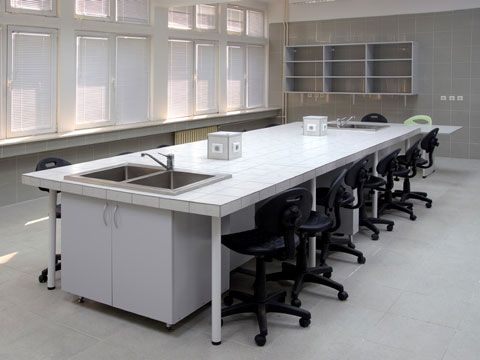 School Science Lab With A Laboratory Table And Chairs