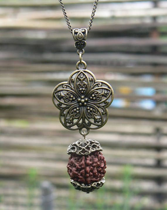 Sacred flower rudraksha seed hindu shanti necklace vegan pendant sacred flower rudraksha seed hindu shanti necklace vegan pendant mukhi rudraksha yoga symbol mozeypictures Image collections