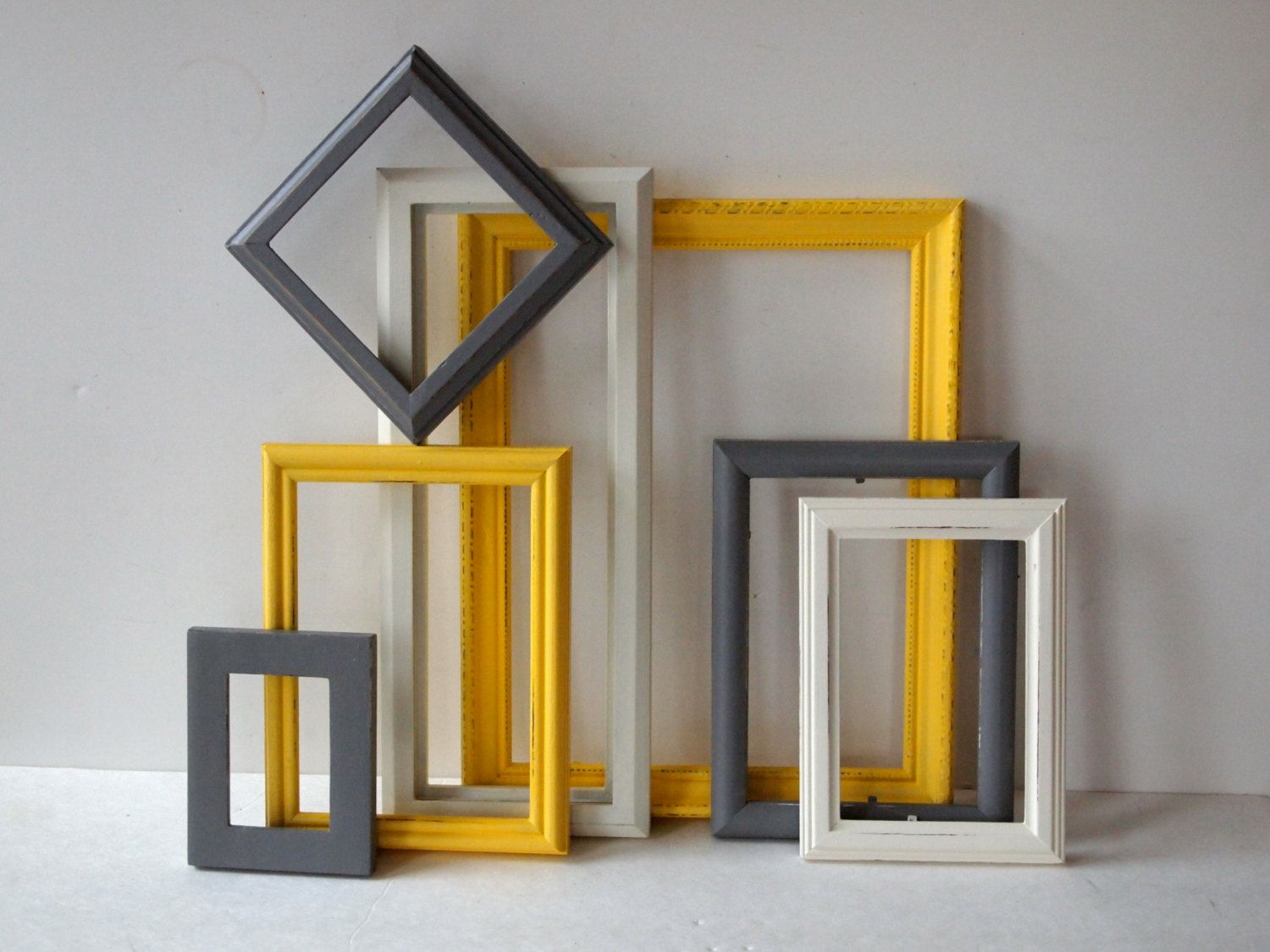 Picture frames vintage wood painted white yellow and grey for Home decor yellow walls