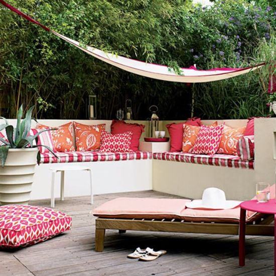 Mixing Striped Pillows with Other Patterns on Patio