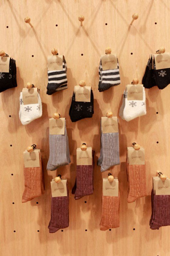 20924571ca Our ingenious sock display pegboard! | shopKEEP | Baby store display ...