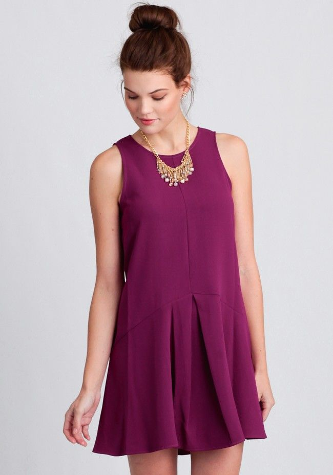 Rendered in a vibrant magenta, this dazzling dress features a drop waist silhouette with a single inverted pleat at the front for a chic and structured look. Complete with a seamed front, this st...