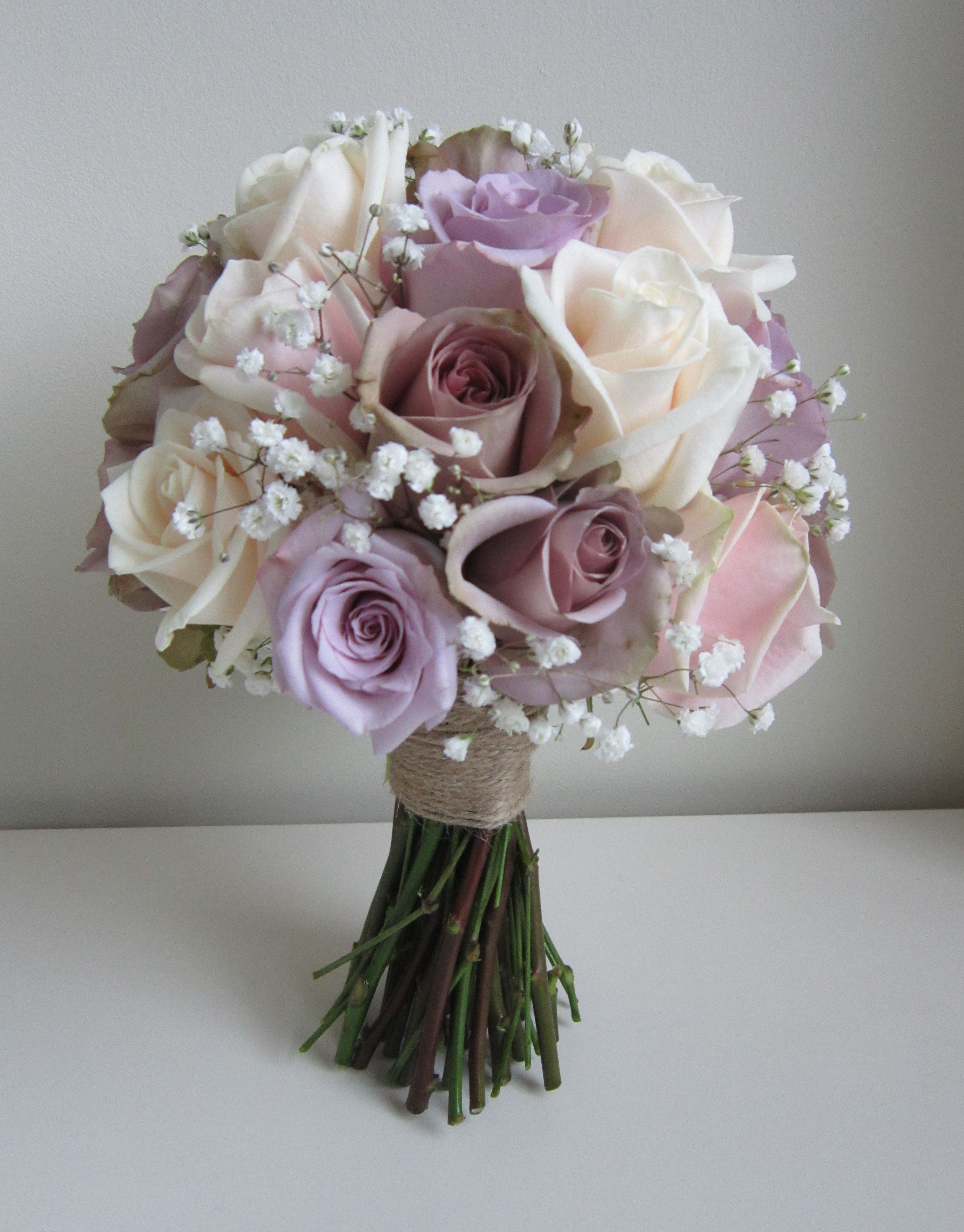 Lilac amnesia roses with lilac ocean song roses and babys breath lilac amnesia roses with lilac ocean song roses and babys breath gypsophilia brides bouquet hand izmirmasajfo Gallery