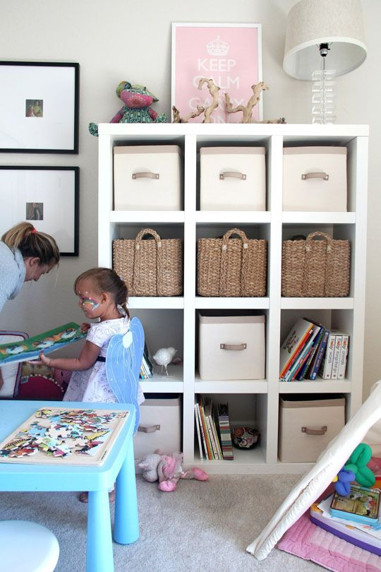 Ikea Expedit for kids toys, books, etc. We have these Serena and Lily bins with shelf from s If we ever need to expand our storage...this is pretty.