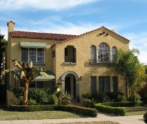 Spanish Style Exterior Paint Paint And Sage Green Awnings On The Exterior Of This Two Story