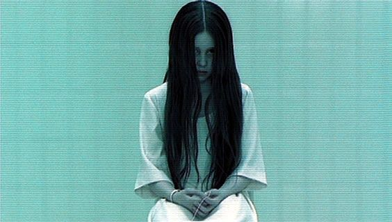 The Creepy Girl From The Ring With Long Black Hair Over Her Face